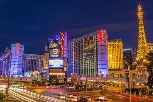 Neon Lights on Las Vegas Strip at Dusk with Car Headlights Leaving Streaks of Light by Eleanor Scriven