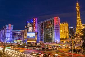 Neon Lights on Las Vegas Strip at Dusk with Car Headlights Leaving Streaks of Light by Eleanor Scriven