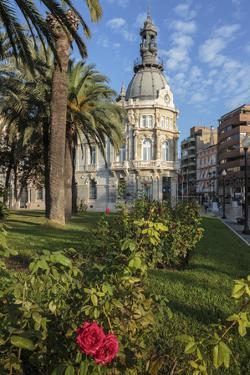 Town Hall under a Cloud Dappled Blue Sky with Palm Trees and Roses, Cartagena, Murcia Region, Spain by Eleanor Scriven