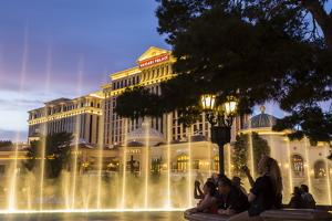 Watching the Bellagio Fountains at Dusk, the Strip, Las Vegas, Nevada, Usa by Eleanor Scriven