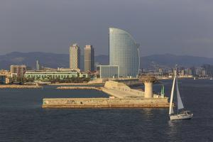 Yacht Sails Past La Barceloneta and the Waterfront by Eleanor Scriven