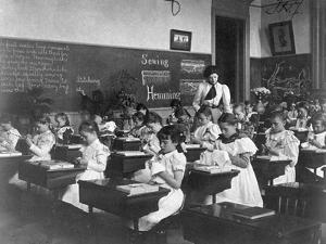 Elementary School Girls Learning Sewing