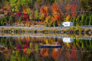Camper Driving Though Fall Forest with Colorful Autumn Leaves Reflecting in Lake. Highway 60 at Lak by elenathewise
