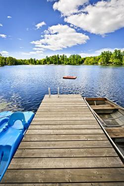 Dock on Lake in Summer Cottage Country by elenathewise