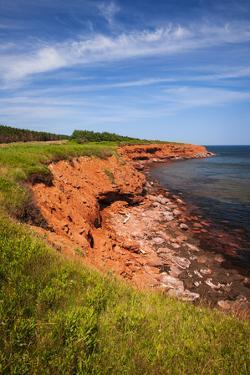 Red Cliffs of Prince Edward Island Atlantic Coast in Green Gables Shore, Pei, Canada. by elenathewise