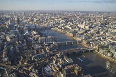 https://imgc.allpostersimages.com/img/posters/elevated-view-of-the-river-thames-and-london-skyline-looking-west-london-england-uk_u-L-PWFSKS0.jpg?p=0
