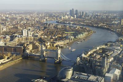 https://imgc.allpostersimages.com/img/posters/elevated-view-of-the-river-thames-looking-east-towards-canary-wharf-with-tower-bridge_u-L-PWFSM40.jpg?p=0