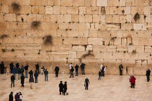 Elevated view of the Western Wall Plaza with people praying at the wailing wall, Jewish Quarter...