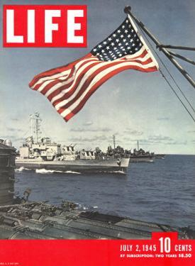 American Flag over US Ships at Sea, July 2, 1945 by Eliot Elisofon