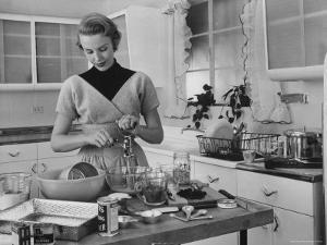 Attractive Housewife in Modern Kitchen, Preparing Food by Eliot Elisofon