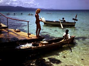 December 1946: Woman and Fishermen at Doctor's Cave Beach in Montego Bay, Jamaica by Eliot Elisofon