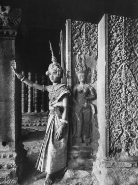 Religious Ritual Dancer in Temple of Angkor Wat, Wearing Richly Embroidered and Ornamented Costumes by Eliot Elisofon