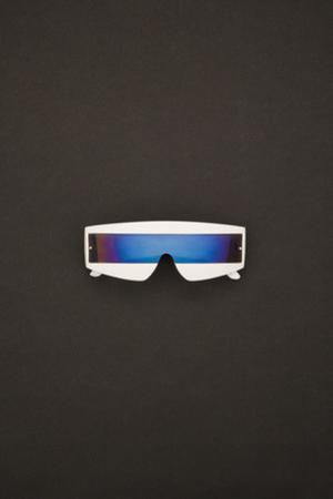 Techno White Sunglasses on a Black Background by Elisabeth LHOMELET
