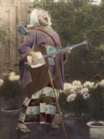 A Japanese woman sings and plays a shamisen. by Eliza R. Scidmore