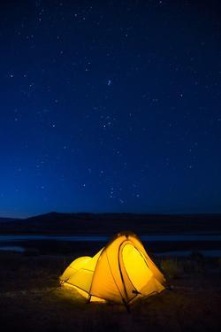 Wyoming, Sublette County. Soda Lake, a tent is lit up at Soda Lake. by Elizabeth Boehm