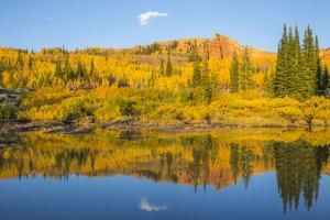 Wyoming, Sublette County. The Red Cliffs in the Wyoming Range mountains is reflected by Elizabeth Boehm