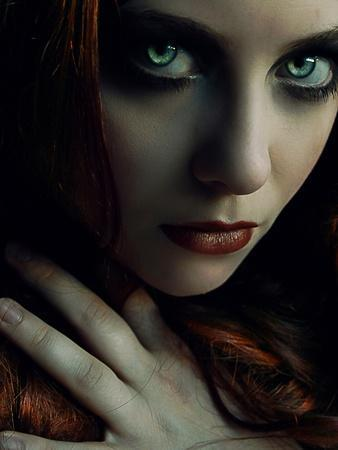 A Girl with Green Eyes in a Dark Setting