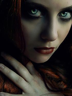 A Girl with Green Eyes in a Dark Setting by Elizabeth May