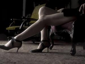 Red Toned Image of Womans Legs by Elizabeth Raab