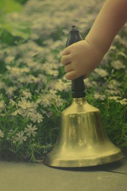 Child's Hand Holding Bell by Elizabeth Urqhurt