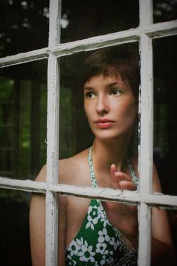 Young Female with Short Hair Behind a Window by Elizabeth Urqhurt