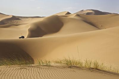 China, Inner Mongolia, Badain Jaran Desert. Vehicle on lip of dune. by Ellen Anon