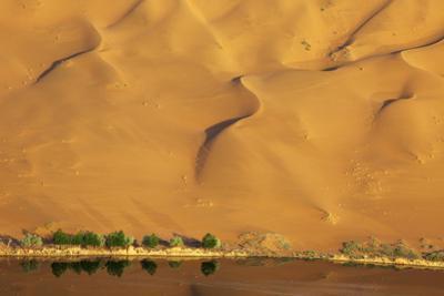 Desert reflection. Badain Jaran Desert, Inner Mongolia, China. by Ellen Anon