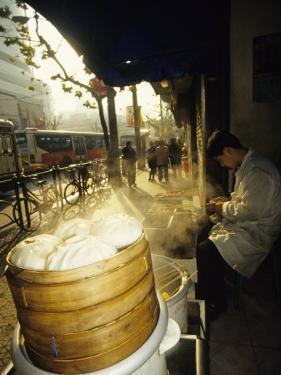 Dumpling Seller, Shanghai, China by Ellen Clark