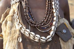 Africa, Ethiopia, South Omo, Hamer tribe. Detail of a necklace and cowrie shells. by Ellen Goff