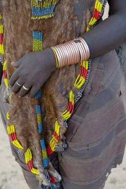 Africa, Ethiopia, South Omo, Hamer tribe. Hamer woman dressed in beaded goatskin. by Ellen Goff