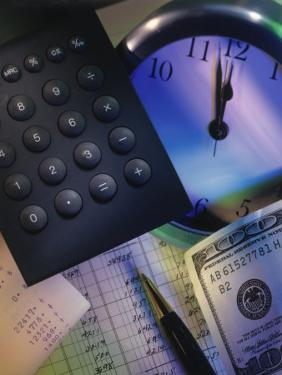 Calculator Over Clock, Spread Sheet and Money by Ellen Kamp