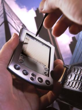 Hand Holding Palm Pilot M500 with Cell Phone by Ellen Kamp