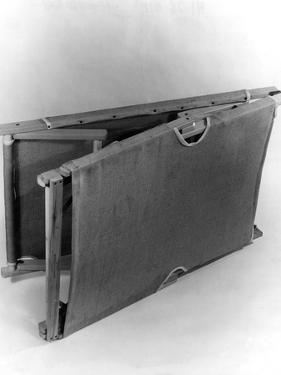Folding Camp Bed by Elsie Collins