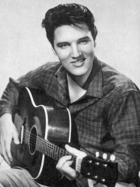 Elvis Presley American Pop Singer Guitarist and Actor in Musical Films Seen Here with His Guitar