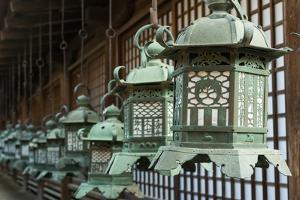 Japanese Style Bronze Lantern Hanging up in the Shrine of  Kasuga Taisha in Nara, Japan. by elwynn