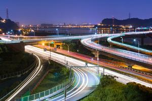 Night Scene of Cars Light at Highway and Interchange in Famous Guandu Bridge, Taipei, Taiwan, Asia. by elwynn
