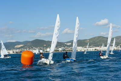 Sailboats Participating in Regatta and Buoy, Ibiza, Balearic Islands, Spain, Mediterranean, Europe by Emanuele Ciccomartino