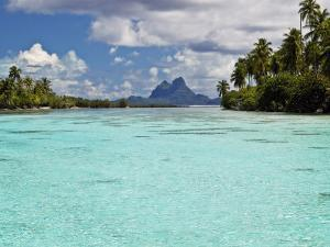 Bora Bora at End of Channel Between Two Motus in Taha'a Lagoon by Emily Riddell