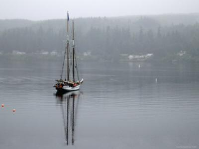 Charter Yacht in Fog, Anchored in Secluded Harbor