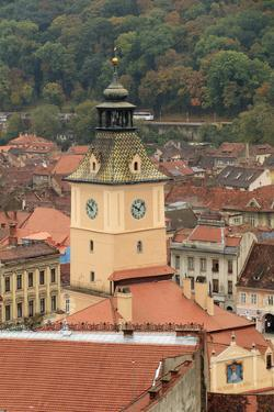 Brasov, Romania. Rooftops and city from hilltop. by Emily Wilson