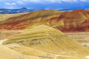 Central OR, Redmond, Bend, Mitchell. Series of low clay hills striped in colorful bands of minerals by Emily Wilson