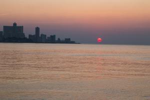 Cuba, Havana. Sunset Along the Malecon, Havana Bay by Emily Wilson