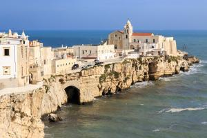 Italy, Foggia, Apulia, Gargano NP, Vieste. Old town of Vieste cityscape with medieval church by Emily Wilson