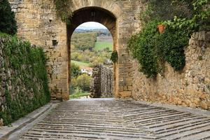 Italy, Monteriggioni. Arched exit-way through city walls by Emily Wilson