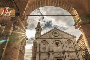 Italy, Val d'Orcia in Tuscany, Pienza. Central Piazza. Santa Maria Assunta Cathedral. by Emily Wilson