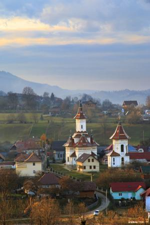 Romania, Bucovina, Campulung Moldovenesc, Fall colors. Churches in valley. by Emily Wilson