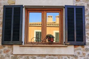 Spain, Balearic Islands, Mallorca. Esporles, Shuttered windows. by Emily Wilson