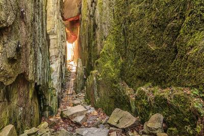 Sweden, Bohuslan Province. Path through wedged rocks near Uddevalla.