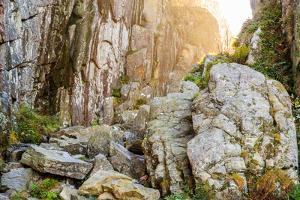 Sweden, Bohuslan Province. Path through wedged rocks near Uddevalla. by Emily Wilson