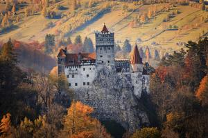 Transylvania, Historic gothic castle in autumn. by Emily Wilson